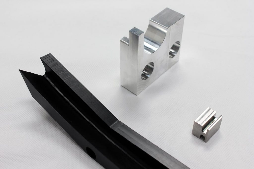 Several CNC Milled Components from Plastic aluminium and stainless steel