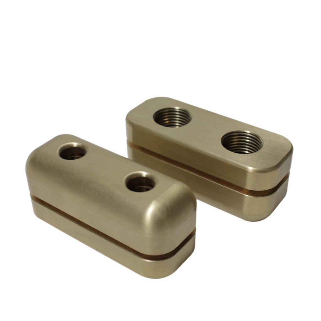 A Pair of CNC Milled Brass Components with undercut slot and threaded holes manufactured in house at Parallel Precision